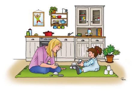 Kind spielt mit Steinen auf dem Boden